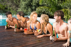 Happy friends enjoying at the swimming pool Stock Photography