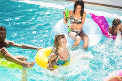 Happy friends enjoying in the swimming pool Royalty Free Stock Images
