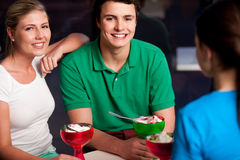 Happy friends enjoying tempting dessert Stock Image