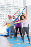 Happy friends exercising with resistance bands Stock Photos