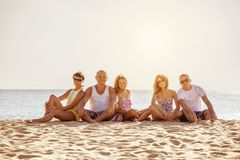 Happy friends family beach holidays concept royalty free stock photos