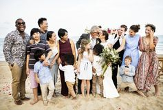 Happy friends and family at a wedding party stock photo