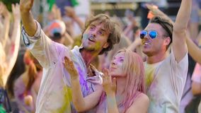 Happy friends filming greeting from open-air music festival on smartphone camera. Stock footage stock footage
