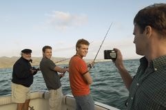 Happy Friends Fishing On Yacht Stock Photography