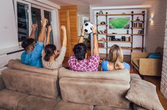 Friends or football fans watching soccer on tv and celebrating victory at home.Friendship, sports and entertainment concept. Happy friends or football fans stock photo