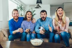 Friends or football fans watching soccer on tv and celebrating victory at home.Friendship, sports and entertainment concept. Happy friends or football fans royalty free stock photography