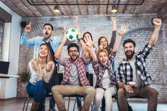 Happy friends or football fans watching soccer on tv. And celebrating victory. Friendship, sports and entertainment concept stock photography