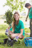 Happy friends gardening for the community Stock Photography