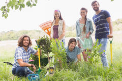 Happy friends gardening for the community. On a sunny day stock images