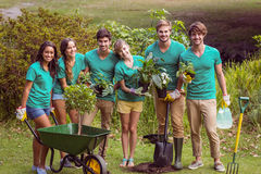 Happy friends gardening for the community. On a sunny day stock image