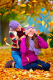 Happy friends, girls playing in vibrant autumn park Stock Photo