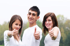 Happy friends giving okey sign. Three young happy friends laughing and giving okey sing Stock Photography