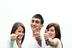 Happy friends giving okey sign. Three young happy friends laughing and giving okey sing Stock Image