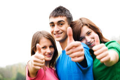 Happy friends giving okey sign. Three young happy friends laughing and giving okey sing Royalty Free Stock Images