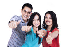 Happy friends giving thumbs up Royalty Free Stock Photos