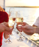 Happy friends with glasses of champagne on yacht. Vacation, trav Royalty Free Stock Photography