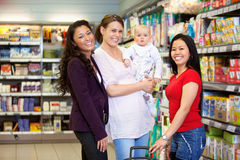 Happy Friends in Grocery Store Stock Photography