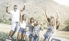 Happy friends group having fun at countryside party ride stock photography