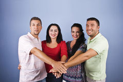 Happy friends with hands together Stock Image