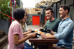 Happy friends having coffee together royalty free stock images
