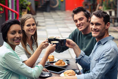 Happy friends having coffee together royalty free stock image