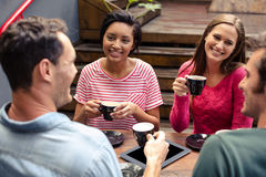 Happy friends having coffee together royalty free stock photography