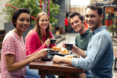 Happy friends having coffee together royalty free stock photos