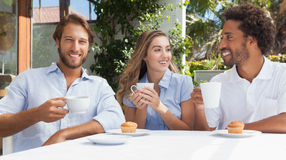 Happy friends having coffee together Stock Image