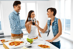 Happy Friends Having Dinner Party Home. Eating Food, Friendship. Stock Photo