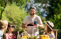 Happy friends having dinner at summer garden party stock photography
