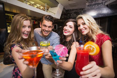 Happy friends having a drink together Stock Images