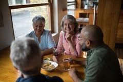 Happy friends having drinks in bar stock photos