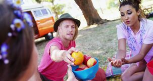 Friends having fruits at music festival 4k. Happy friends having fruits at music festival 4k stock footage