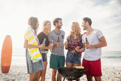 Happy friends having fun around barbecue Stock Images