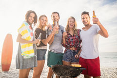 Happy friends having fun around barbecue Stock Photos