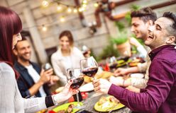 Free Happy Friends Having Fun Drinking Red Wine On Balcony At Private Dinner Party - Young People Eating Bbq Food At Fashion Restaurant Stock Image - 193640781