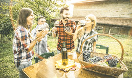 Happy friends having fun drinking wine at winery vineyard. Happy friends having fun drinking at winery vineyard - Friendship concept with young people enjoying Royalty Free Stock Image