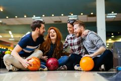 Cheerful friends bowling together Royalty Free Stock Photo