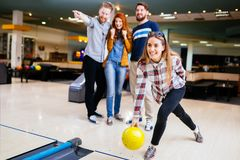Competitve people enjoying bowling Stock Image