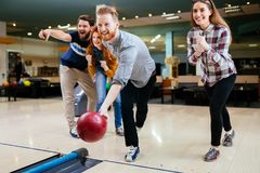 Friends bowling and having fun Royalty Free Stock Photos