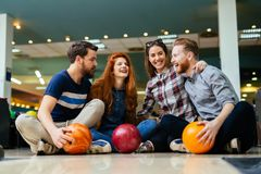 Friends enjoying bowling at club Royalty Free Stock Photography
