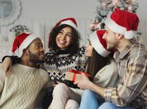 Happy friends having fun near new year tree royalty free stock images