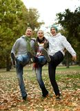 Happy friends having fun in park laughing. Happy young friends having fun in park, laughing Stock Photography
