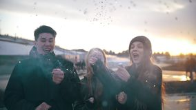 Happy friends having fun with party poppers confetti at sunset stock footage
