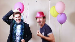 Happy friends having fun with props in photo booth stock video