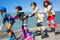 Happy friends having fun while rollerblading Royalty Free Stock Photo