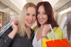 Happy friends having fun while shopping in a mall Stock Photography