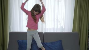 Happy friends having fun together. Two girls fighting pillows. friendly match stock video footage