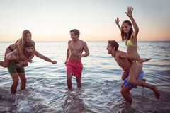 Happy friends having fun in the water Stock Photography