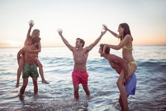 Happy friends having fun in the water Royalty Free Stock Photography
